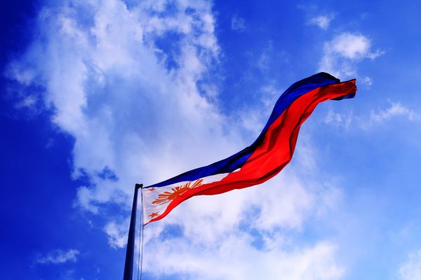 The flag of the Philippines on a flagpole